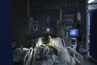 A COVID-19 patient receives treatment in an ICU.