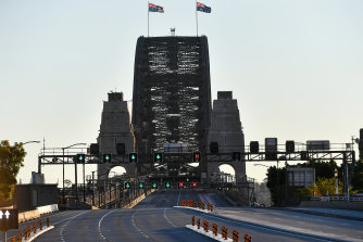 A fairly empty Sydney Harbour Bridge is seen on Sunday June 27, the city's first day of lockdown.