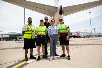 Virgin Australia boss Jayne Hrdlicka, centre, will announce stand downs.