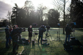 Members of the media prepare to broadcast from within the Sandringham estate near King's Avenue ahead of Prince Harry arriving to meet with Queen Elizabeth II.