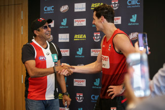 Cricket great Wasim Akram shakes Jake Carlisle's hand at St Kilda on Monday.