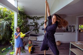 Amanda Montoya, who is a competitive pole dancer, with kids Arrow, 3, and Luna, 10.
