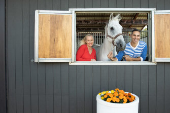 """The couple with Bono, one of their horses: """"Life is certainly not boring."""""""