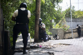 Police search the Morne Calvaire district of Petion Ville for suspects who remain at large in the murder of Haitian President Jovenel Moise in Port-au-Prince, Haiti.