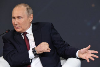 Vladimir Putin, pictured here on June 5 at an economic forum, has denied he owns a palace on the Black Sea, as alleged by Navalny.