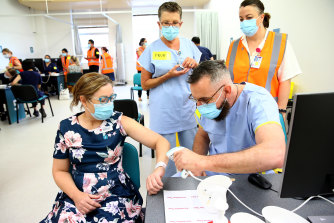 NSW front line health workers getting the COVID-19 vaccine earlier this year.
