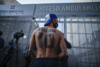 Soccer fans gather outside Clinica Olivos where former soccer star Diego Maradona was to undergo surgery before his death.