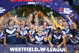 Oh so sweet: Melbourne Victory celebrate their title triumph.