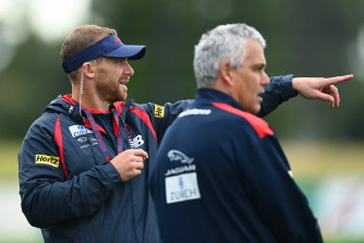 Melbourne coach Simon Goodwin and assistant Mark Williams at training at Casey Fields on Monday.