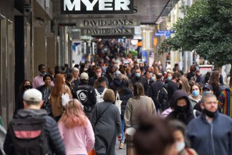 Crowds in Bourke Street Mall on Sunday. The CBD still faces a long road to recovery, research shows.