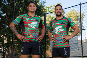 Latrell Mitchell and Cody Walker model the 2021 South Sydney Indigenous jersey.