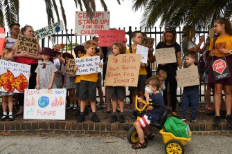 Sydney primary school students and parents demand urgent action on climate change during a protest last year.