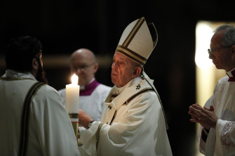 Pope Francis presides over a solemn Easter vigil ceremony in a nearly empty St Peter's Basilica.