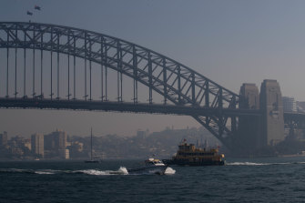 Haze over Sydney Harbour on Tuesday from hazard reduction burns.