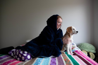 Rachael Hayward keeps warm by wearing an Oodie, saving on heating costs in Sydney.