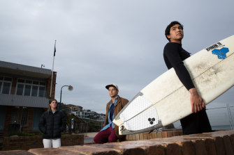 Bella Keating-Follas, Tom Chapman and Luke Morris of the Bronte Boardriders are among those who object to an expansion of the surf club building that would encroach on public space at the Sydney beach.