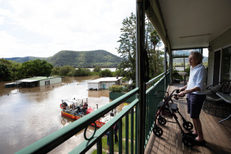 Patricia Parker, 86, views her submerged home from the safety of her son and daughter-in-law's balcony.
