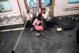 Police shoot pepper spray at protesters inside a train at Prince Edward Station, in Hong Kong, August 31, 2019.