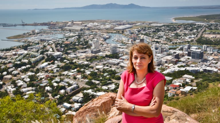 Townsville Mayor Jenny Hill on top of Castle Hill  with Townsville in the background.