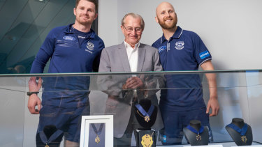 Geelong players Patrick Dangerfield (left), Charles Brownlow and Gary Ablett pose for a photo with the first Brownlow medal at GMHBA Stadium in Geelong. The first Brownlow medal, won in 1924 by Cat's player Edward Greeves, has been purchased by the club and will be on display at the stadium.