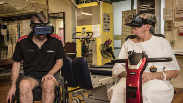 Joshua Gough, left, uses a VR headset at Prince of Wales Hospital.