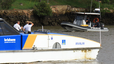Police search the Brisbane River on Wednesday.