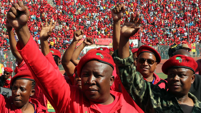 """""""Time for justice"""": Julius Malema, leader of South Africa's radical left Economic Freedom Fighters party, centre."""