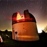 High over big city's bright lights, old observatory finds new audience