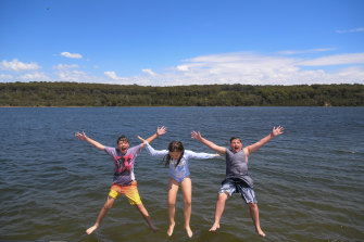 Liam, 12, Indy, 8, and Blaze, 13, cool off at Lysterfield Lake on Monday