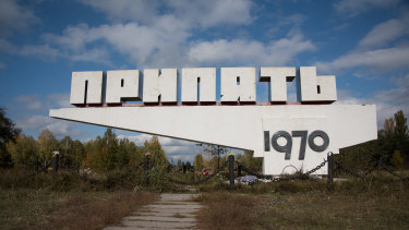Flower offerings sit at the bottom of the Pripyat welcome sign. Founded in 1970 as a nuclear satellite city, the town is located only three kilometres away from the power plant.