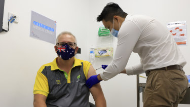 Prime Minister Scott Morrison receives the COVID-19 vaccine on Sunday.
