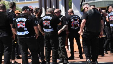 Rebels bikies arrive at the funeral home.