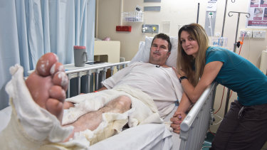 36-year-old volunteer firefighter Chris Unstead with his wife Sam in his room at Royal Perth Hospital.