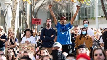 Protesters rally outside Rio Tinto's Perth headquarters.