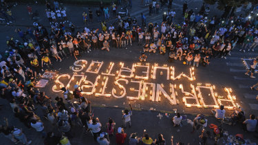 Demonstrators take part in a candlelight vigil for the victims of the past days of protests in Cali, Colombia.