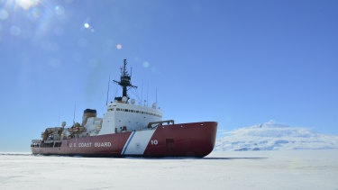The Coast Guard Cutter Polar Star breaks ice in McMurdo Sound near Antarctica in support of Operation Deep Freeze.