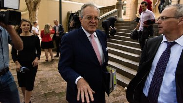 Chris Dawson's lawyer Greg Walsh leaves Central Local Court in Sydney.