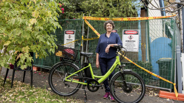 Melanie Sandford is locked out of her destroyed home in Leichhardt, but back on her e-bike.