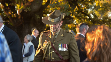 Servicemen and women socialise after the Dawn Service.