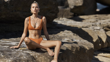 "Bondi Born ""Matilda"" top, $160, and ""Nadia"" bottoms, $120. Louise Olsen x Alex and Trahanas ""Chifferi"" hoop earrings, $240 (small) and $290 (large). Holly Ryan ""Picasso"" gold necklace, $420, and ""Joan"" gold necklace, $540 (all jewellery worn throughout"