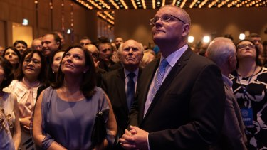 Scott Morrison and his wife Jenny, with former prime minister John Howard, await the result of the NSW election in Sydney.
