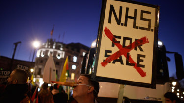 A protester at a NHS rally during a visit to London by US President Donald Trump.