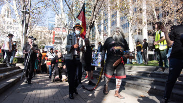 Protest organisers Uncle Ben and Herbert Bropho march to Rio Tinto's headquarters to hand over a letter of demands.