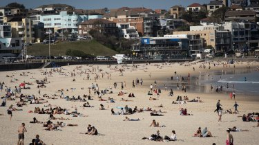 Keen swimmers hit the water at Bondi Beach.