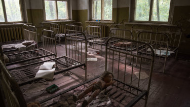 A room inside an abandoned kindergarten and children's home in Zalissya ghost town, located inside the exclusion zone.