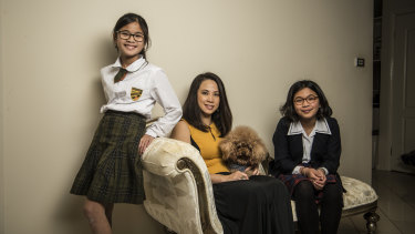 """""""The standard is higher"""": Yuliana Hartanto with her two daughters, Sienna, 12, and Felicia, 15."""