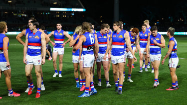 The Western Bulldogs walk off after their 13-point loss to ladder leaders Port Adelaide.