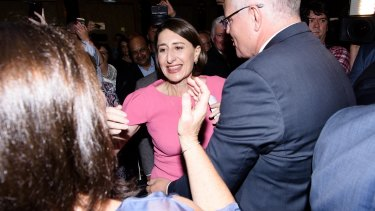 NSW Premier Gladys Berejiklian is greeted by Prime Minister Scott Morrison as she enters the ballroom of the Sofitel Wentworth for her victory celebrations.