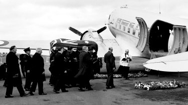 The coffin of Prime Minister Ben Chifley is loaded onto an aircraft in Canberra on 16 June 1951, headed for Bathurst, NSW, for his funeral the following day.