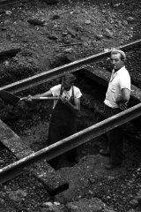 Workmen remove tram tracks on the Sydney Harbour Bridge on 30 June 1958.